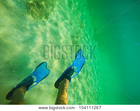 Scuba Fins Underwater In Sardinia