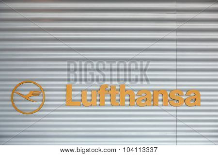 Lufthansa logo on wall at Frankfurt airport