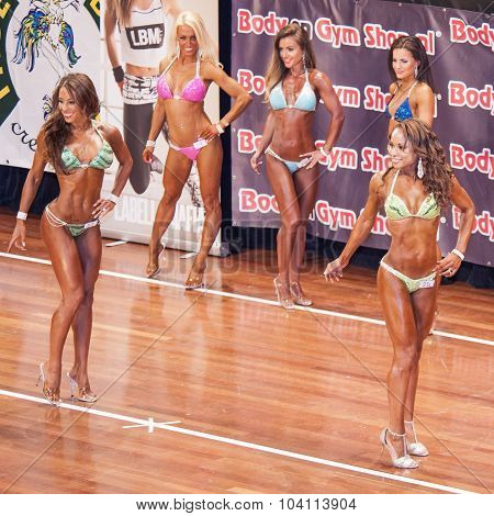Female Fitness Models Show Their Best Side In A Lineup