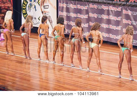 Female Fitness Models Show Their Back Side In A Lineup