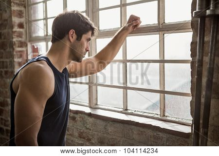 Man looking outside window at the gym