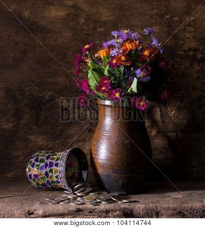 Flowers In Vase And Pile Of Old Coins