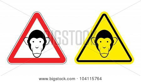 Warning Sign Attention Monkey. Hazard Yellow Sign Head Monkeys. Silhouette Chimp Ball On  Red Triang