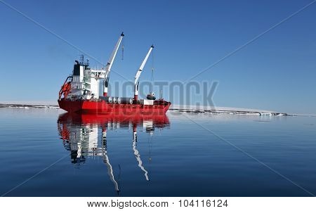 Cargo ship with cranes in Arctic