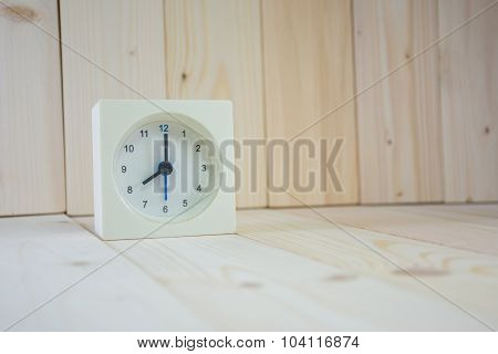 The Time Is Now 8.00 Am, On Wooden Table.