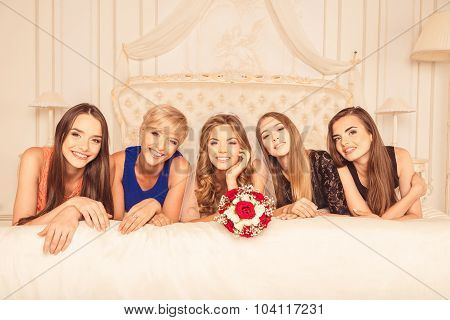 Cute Girls Celebrating A Bachelorette Party Of Bride Liying On The Bed