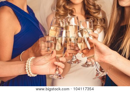 At Party Happy Girls Clink Their Glasses With Champagne