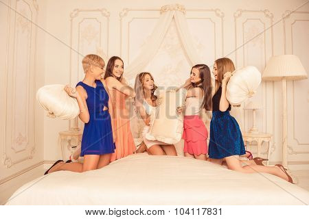 Cheerful Girls Celebrating A Bachelorette Party And Playing With Pillows