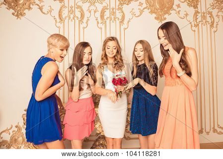Cheerful Girls Celebrating A Bachelorette Party Of Bride Watching At The Ring