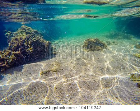 Rocks, Seaweeds And Sand In Sardinia