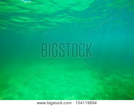 Sandy Sea Floor Under Green Water In Sardinia