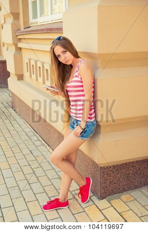 Attractive Young Woman In Casual Style With Phone