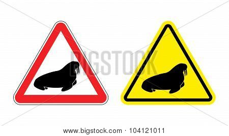 Warning Sign Attention Walrus. Hazard Yellow Sign The Seal. Silhouette Of Arctic Animal With Fangs O