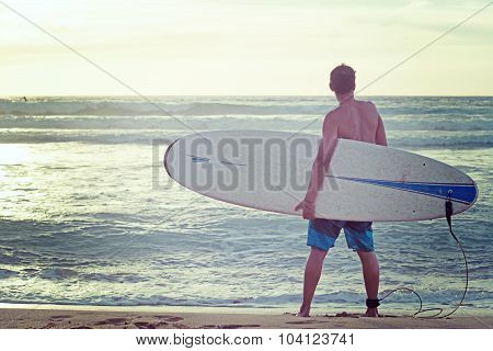Standing On The Beach With A Surfboard