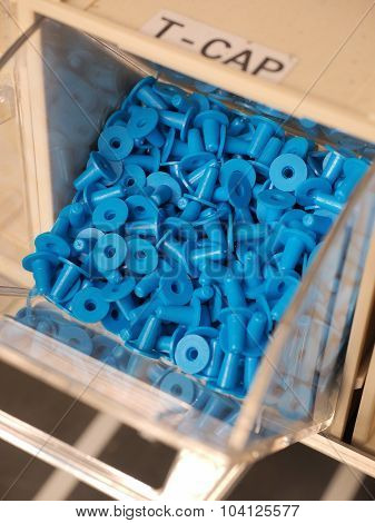 T -shaped plastic plugs in a storage organizer