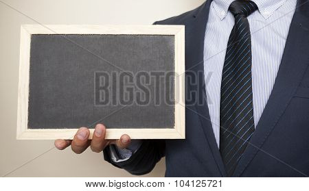 Businessman holding a blackboard