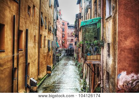 Narrow Canal In Bologna Downtown
