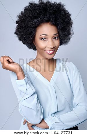 Confident friendly black african businesswoman smiling in studio, isolated on grey background