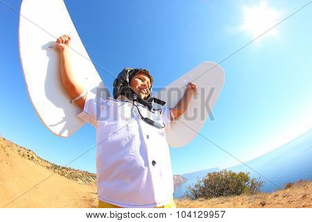kid with wings and flying helmet