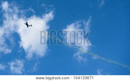Kharkiv, Ukraine - August 24, 2015: plane with colorful trail in the sky at Kharkiv airshow