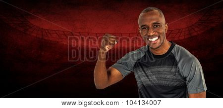 Portrait of sportsman cheering after success in rugby against rugby stadium