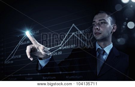 Young businessman touching icon of graphic on media screen