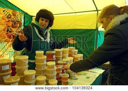 MOSCOW, RUSSIA - OCTOBER 04, 2015: Traditional Food Fair on the weekend. Women buy and sell honey.