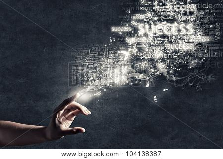 Close up of human hand touch and success conceptual words