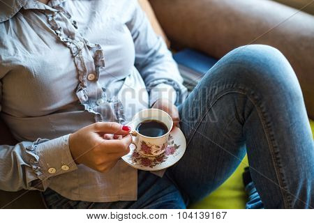 Relaxed Woman Holding Vintage Cup Of Coffee In Hands