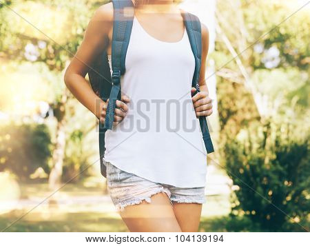 Young woman wearing blank tshirt and backpack