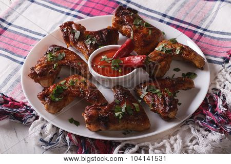 Tasty Grilled Chicken Wings With Chili Peppers Close-up. Horizontal