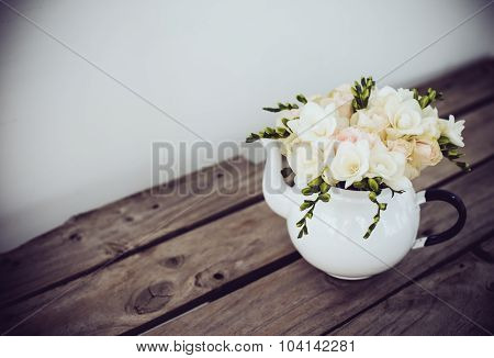 white roses and freesias