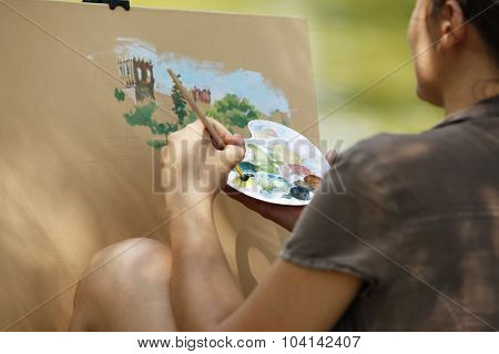A Young Girl Paints A Picture