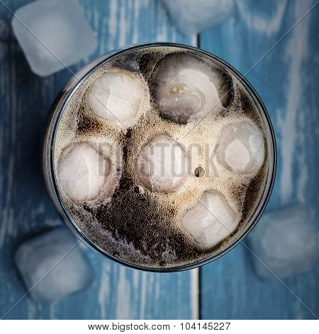 Cola In Glass With Ice From Top.