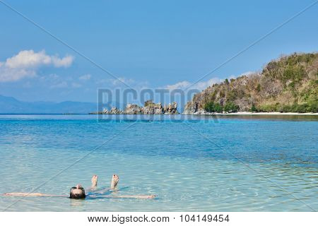 woman tourist sun bathing swimming in Palawan Philippines