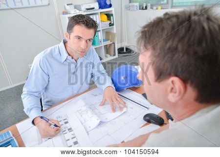 Architect meeting with his client