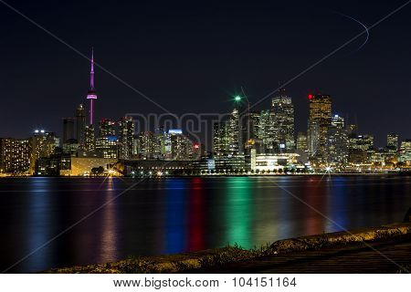 Toronto skyline at night taken from a local pier.