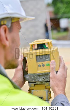 Surveyor taking a measurement