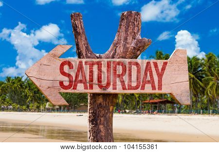 Saturday arrow with beach background
