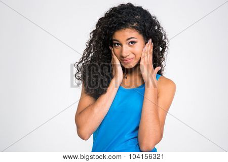 Portrait of a african woman covering her ears isolated on a white background