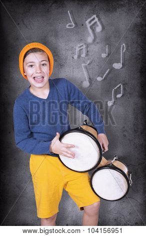 Boy In Front Of Blackboard With Drums