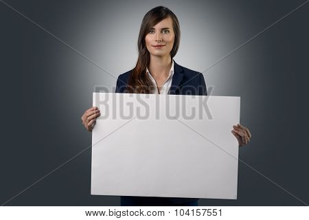 Attractive Businesswoman Holding A White Sign