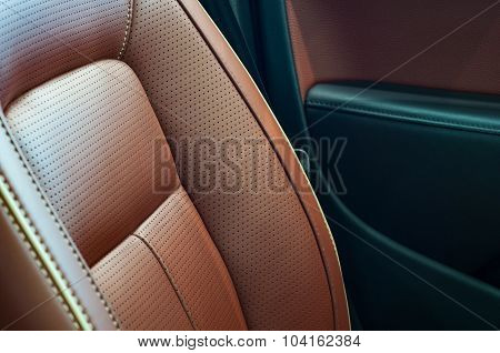 Brown red pefrorated leather