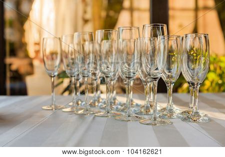 A row of empty champagne glasses