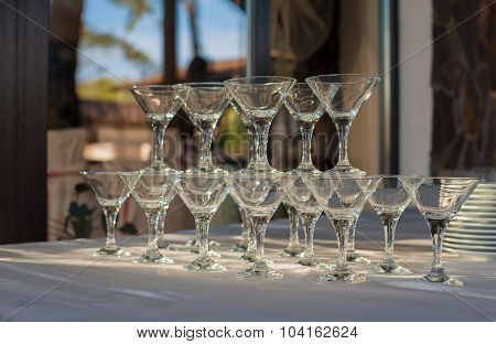 A row of empty martini glasses