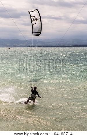 Kiteboarder surfing waves with kiteboard