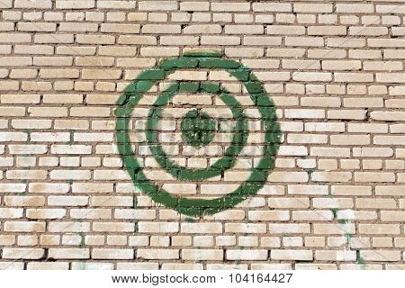 Green Painted Target On Brick Wall.