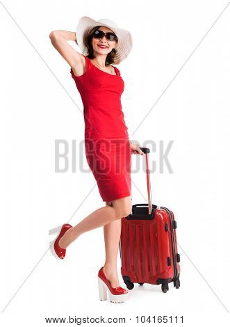 beautiful girl with red suitcase and hat going on vacation