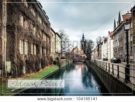 postcard with canal and old historic buildings in the old town of Gdansk, Poland