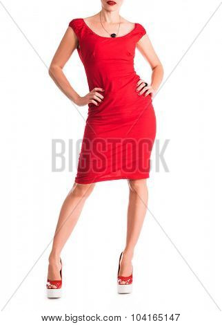 girl`s figure in red dress with hands on the sides